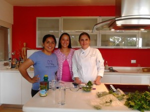 Adriana Sanchez from MIA, Monika Marroquin and Chef Euda Morales cooking recipes using Chaya.