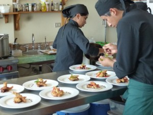 Culinary students preparing meals for the CECAP Cafe.
