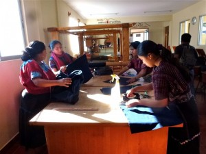 Sewing students making products for sale