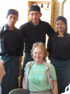 Penny visiting the young cooks at Cafe Cruceno.