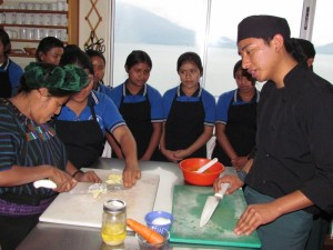 Chef Juan Carlos teaching women how to make healthy lunches.