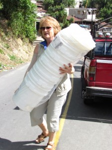 Penny Rambacher in action carrying water filters.
