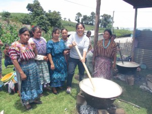 "Adriana with the women leaders making the ""atol"" (hot masa dough beverage)"