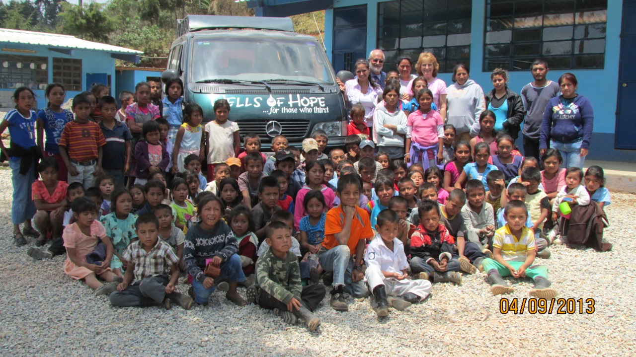 children in front of their new school