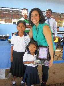 Veronica Garcia-Melendez receives a gift from the students.