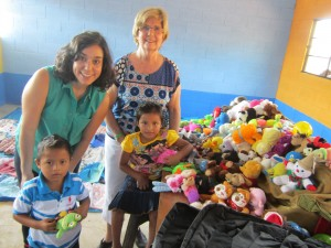 Each student received a backpack and a small stuffed animal or toy. School supplies (pens, pencils, glue, crayons, notebooks, etc.) were left with the teachers for distribution.